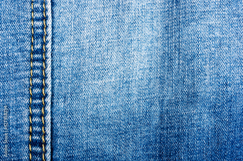Fotografia, Obraz clothing items blue stonewashed faded jeans cotton fabric texture with seams, cl
