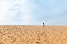 Young Girl Climbing Sleeping Bear Sand Dunes In Glen Arbor Michigan