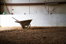 Manure Wheelbarrel In Riding Stable