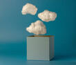 Box and clouds on blue background. Creative thinking concept. Think outside the box.
