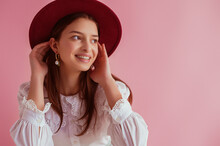 Happy Smiling Elegant Girl Wearing Stylish Burgundy Color Hat, Pearl Earrings, Vintage Blouse, Posing On Pink Background. Women`s Fashion Conception. Copy, Empty Space For Text