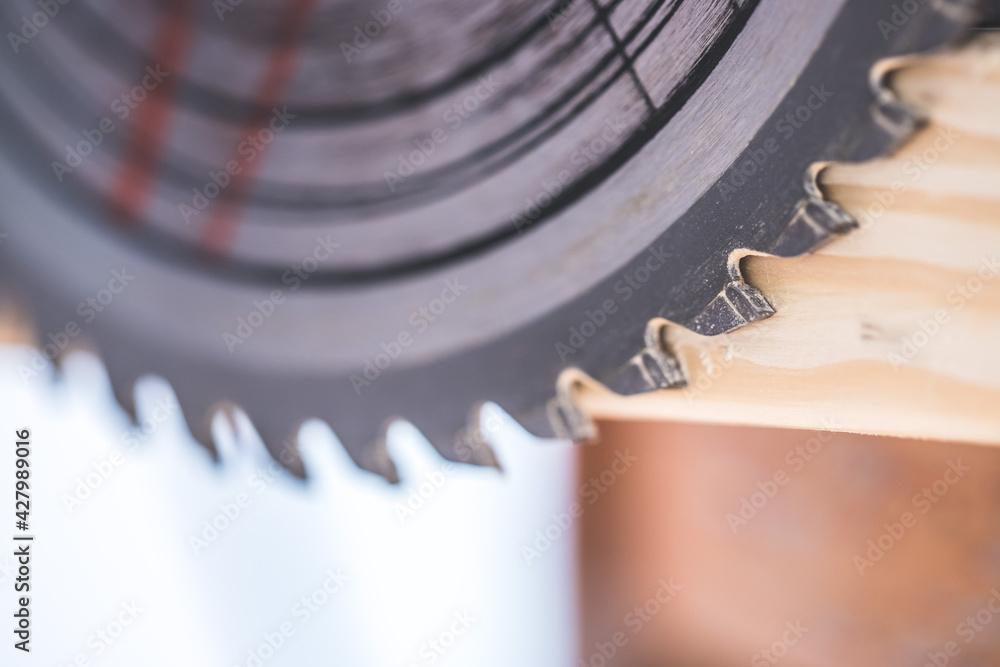 Fototapeta Woodwork at a carpenter: Close up of circular saw blade
