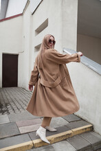 Female Fashion Model, Posing For A Full Length Photo, Wearing Total Beige Outfit, Street Fashion