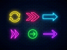 Neon Arrow Signs Collection. Set Of Colorful Neon Arrows, Web Icons. Bright Arrow Pointer Symbols On Brick Wall Background. Banner Design, Bright Advertising Signboard Elements. Vector Illustration.