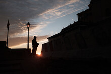 Silhouette Of A Woman Watching The Sunset In Genova.
