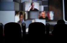 People Looking Movies At Cinema