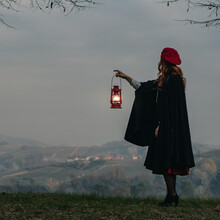 Woman Holding A Red Lantern