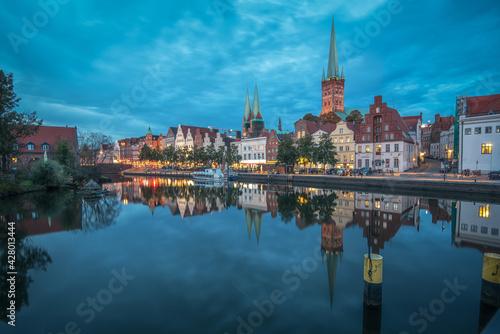 Lübeck an der Trave an einem Abend im Herbst bei leicht bewölkten Himmel zur bla Wallpaper Mural