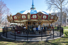 An Empty, Colorful, Old Fashion Carousel For Kids In A Park In Philadelphia