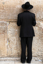 Jerusalem: Religious Man Praying At The Wailing Wall Or Western Wall