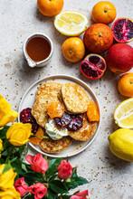 Lemon Pancakes With Citrus Fruits, Including Blood Oranges And Pomegranates
