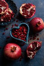 Pomegranates On Blue Background