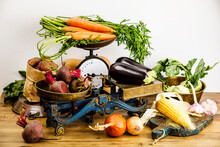 Fresh Raw Ripe Vegetables Healthy Food On Scales On Wooden Table Background