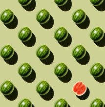 Fresh Watermelon Design, With A Single Halved Watermelon, On Green Background Pattern