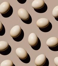 Chicken Eggs On Beige Background Pattern