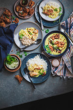 Khadi Chawal Indian Cuisine With Side Servings On A Dark Table
