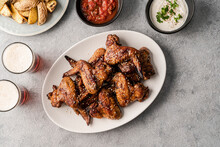 Teriyaki Chicken Wings With Dips, Beer, And Potato Wedges