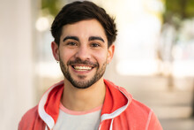 Close-up Of Young Man Smiling Outdoors.