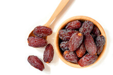Medjool Dates Or Dates Fruit In Wooden Cups And Spoons Isolate On White Background, Top View.