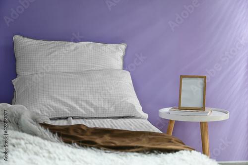 Fototapeta Modern bedside table in interior of bedroom obraz na płótnie
