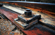 The Rusty Iron Bolts On The Railway