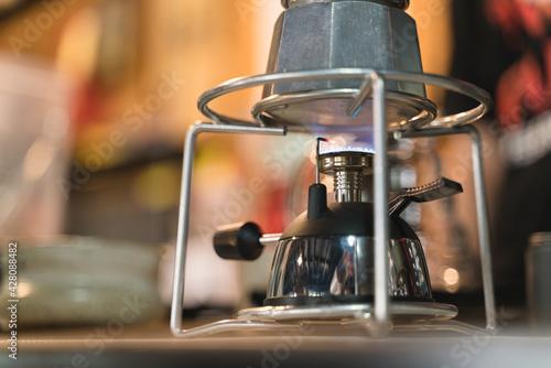 Obraz Brewing espresso coffee by Italian Moka pot gas stove - fototapety do salonu