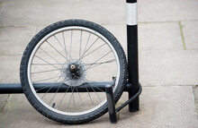Bicycle Theft - Rear Wheel Of Bicycle With Lock Attached To Bike Rack. All That Remains After The Bicycle Was Stolen.