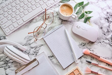 Workplace Mockup With Notebook, Glasses, Headphones And Make Up Accessories