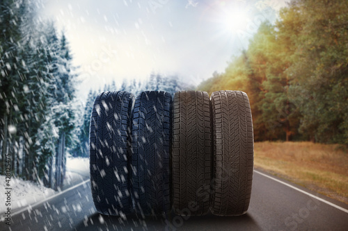 Obraz Set of new winter and summer tires on asphalt road, collage - fototapety do salonu