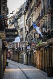 Fototapeta Uliczki - San Sebastian, Spain - Jan 10, 2021: the narrow streets and Pintxo bars of Parte Vieja in the early morning