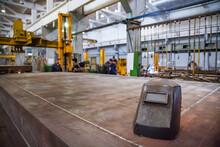 Train Car-building Plant. Workshop Interior. Welder Mask On Sheet Metal. Focus On Mask.