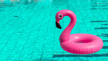 Beach Flamingo. Pink Inflatable Flamingo In Pool Water For Summer Beach Background. Trendy Summer Concept.