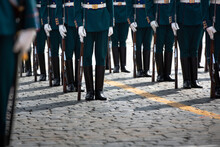 The Feet Of The Soldiers In The Parade. Polished Boots, White Gloves, Rifles.