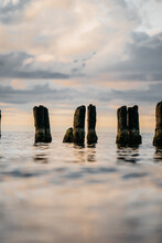 Vertical Shot Of Wooden Wave Breakers On A Coast Of The Baltic Sea