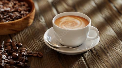 Obraz na plátně Frische Tasse Kaffee mit Kaffeebohnen auf Tisch