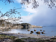 Ranvika Cove In Norway With Rocky Cliffs Around And Framed By Thin Trees