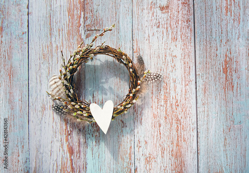 pussy willow twigs wreath and heart on wooden rustic background Fototapeta