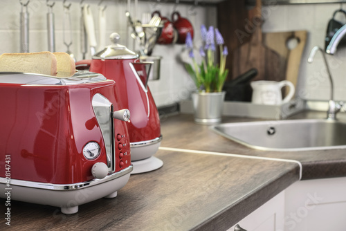 Red toaster and electric kettle in retro slile - fototapety na wymiar