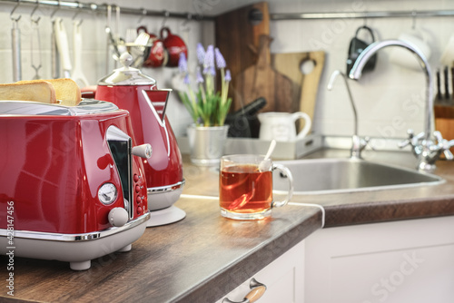 Red electric kettle and toaster  in retro slile - fototapety na wymiar