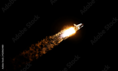 Fotografie, Obraz Space rocket shuttle with blast and puffs of smoke against the black sky