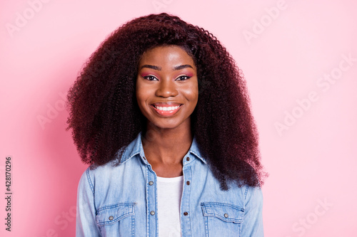 Fototapeta Portrait of attractive content cheerful wavy-haired girl wearing denim blazer isolated over pink pastel color background obraz