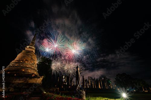 Fototapeta Firework of Loy Krathong festival showing in Sukhothai historical park