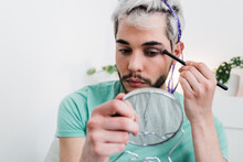 Drag Queen Applying Make Up Indoors At Home - Lgbt Concept - Focus On Eyes