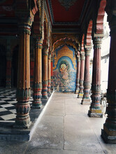 Varanasi, India: Interior Of An Empty Ancient Hindu Temple With Stone Carved Design, Pillars With Checker Marble Floor And An Image Of Saraswati Goddess On Wall . Uttar Pradesh.