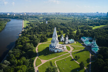 Seen From Above Of The White Church Of The Ascension In Moscow, Russia. People Are Resting On Lawn In The Public Park By The River