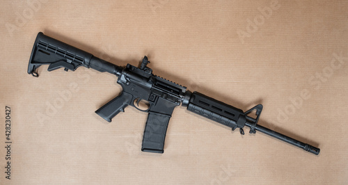 Fotografering Loaded AR-15 semi-auto assault rifle gun with a 30 round magazine