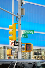 Broadway Road Sign And Traffic Light At The Times Square, New York City, Selective Focus, USA.