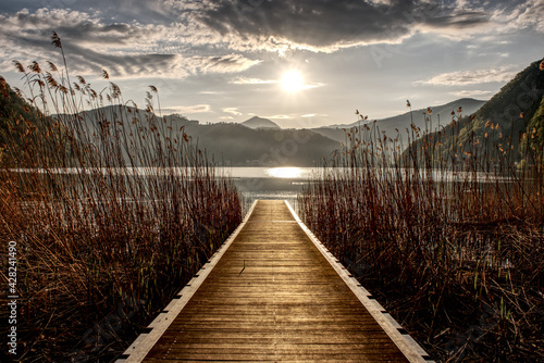 Jetty into Lake Lugano at sunrise  - fototapety na wymiar