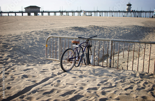 Bicycle locked up on beach sand #428288279