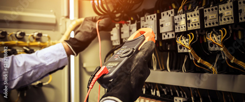 Obraz na plátne Electricity and electrical maintenance service, Engineer checking electric at circuit breaker and cable wiring system for repairing main power distribution board